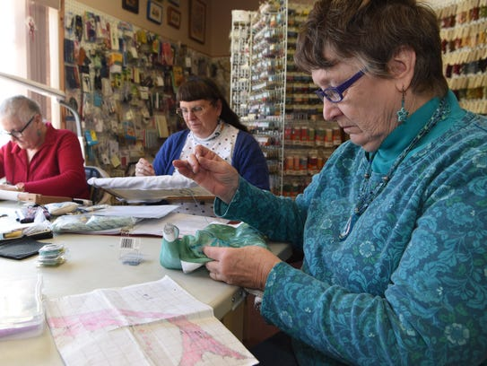 Pat Athanas, right, owner of Deer Hill Farm Cross Stitching