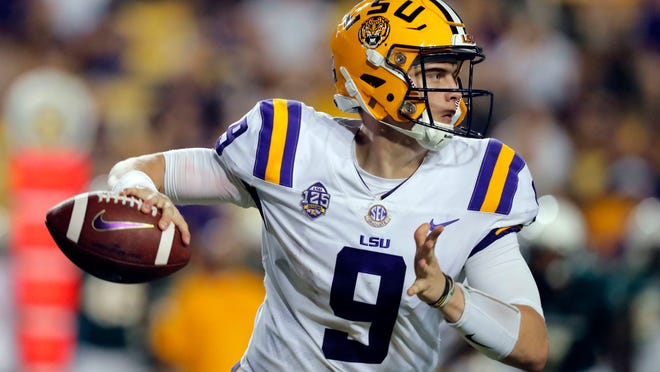 FILE - In this Saturday, Sept. 8, 2018, file photo, LSU quarterback Joe Burrow (9) scrambles as he looks for a receiver in the second half of an NCAA college football game against Southeastern Louisiana in Baton Rouge, La. Burrow says he's not entirely happy with how he's played, but he suspects the sixth-ranked Tigers' passing game is on the cusp of considerable improvement. (AP Photo/Gerald Herbert, File)