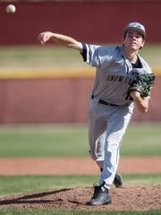 Snow Canyon High School pitcher Breck Eichelberger strikes out a Cedar High School batter at CHS Tuesday, April 3, 2018.