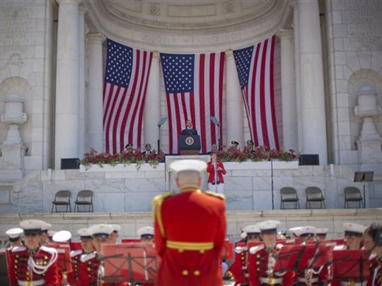 President Barack Obama speaks during a Memorial Day Observance at Arlington National Cemetery in Arlington, Va., Monday, May 25, 2015. Playing just below Obama in the Memorial Amphitheater are members of The President's Own, United States Marine Band.