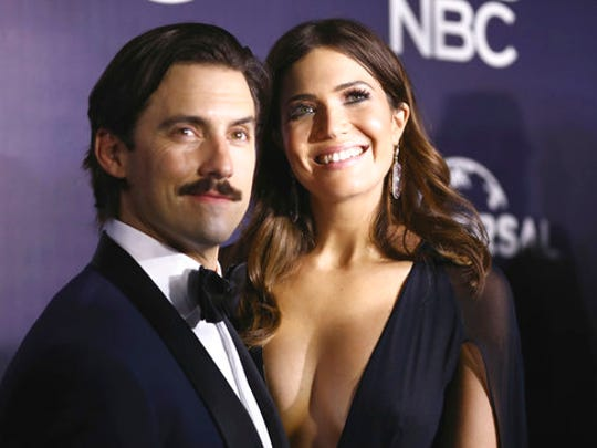 FILE - This Jan. 8, 2017 file photo shows Milo Ventimiglia, left, and Mandy Moore at the NBCUniversal Golden Globes afterparty in Beverly Hills, Calif. The season finale for the popular  time-twisting family drama will air Tuesday at 9 p.m. EST on NBC.