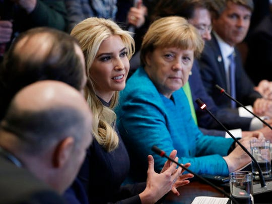 FILE - In this Friday, March 17, 2017, file photo, German Chancellor Angela Merkel listens as Ivanka Trump speaks during a meeting with President Donald Trump at the White House in Washington. Ivanka Trump's company continues to grow. Ethics lawyers fear the more her business expands, the more it may encroach on her ability, and husband, Jared Kushner, to credibly advise the president on core issues.