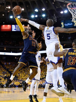 Cleveland Cavaliers forward LeBron James (23) shoots the ball against Golden State Warriors center Marreese Speights (5) during the third quarter in game two of the NBA Finals at Oracle Arena.