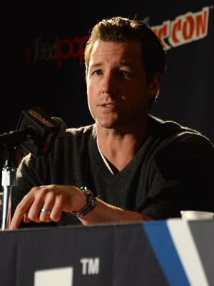 Ed Burns speaks onstage at the 'Mob City' panel during New York Comic Con 2013 on Oct. 12.