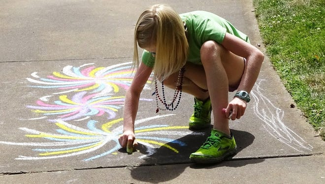 Sidewalk chalk art is one way to pass the time on sunny school days off in the Mid-Willamette Valley.