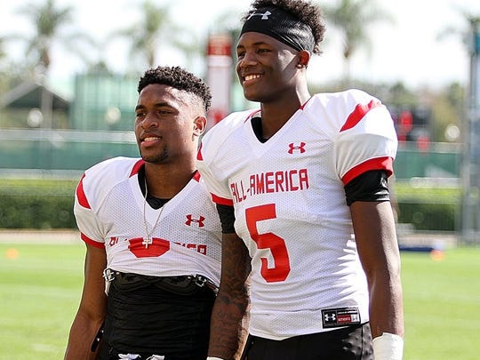 Catholic wide receiver Amari Rodgers, left, and Oak Ridge wide receiver Tee Higgins pose for a picture during practice for the Under Armour All-America Game. Both players are committed to Clemson.