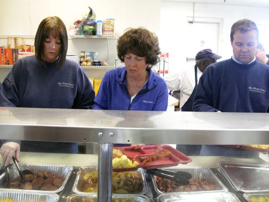 News Leader staff Susan Armstrong (left), Kathy Myers (center and publisher Roger Watson (right) serve an old fashioned Southern breakfast to residents of Valley Mission as part of Make A Difference Day, a national day of community service on Oct. 25 co-sponsored by The News Leader's parent company Gannett. The residents will use six new computers and associated gear donated by The News Leader to search and apply for jobs.