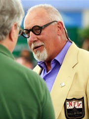 Football Hall of Famer Randy White greeted fan at his alma mater McKean High School's 50th anniversary in 2017.