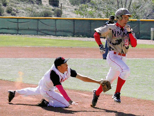 Danny Udero/Sun-News   Cobre shortstop Andru Sanchez dives to tag a baserunner during action Saturday at Howie Morales Stadium.