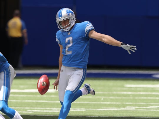 Kasey Redfern punts against the Colts during the third quarter of the Lions' 24-10 exhibition win Aug. 13, 2017 in Indianapolis.