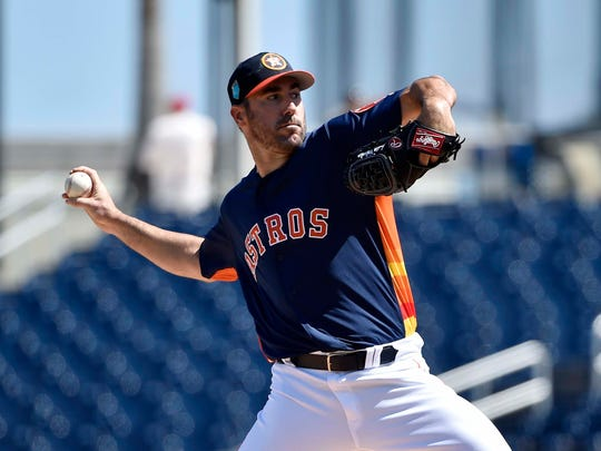 Houston Astros starting pitcher Justin Verlander (35) delivers a pitch during a spring training game against the Washington Nationals at The Ballpark of the Palm Beaches.