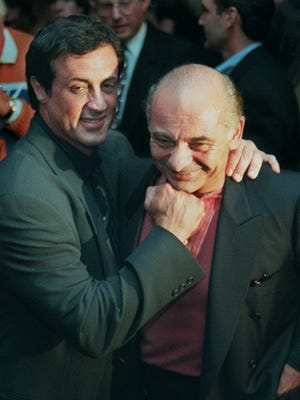 "Sylvester Stallone, left, mugs with ""Rocky"" co-star Burt Young before a screening of the 1976 film to celebrate its 20th anniversary, at the Academy of Motion Picture Arts & Sciences in Beverly Hills."