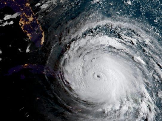 This satellite image shows Hurricane Irma illuminating