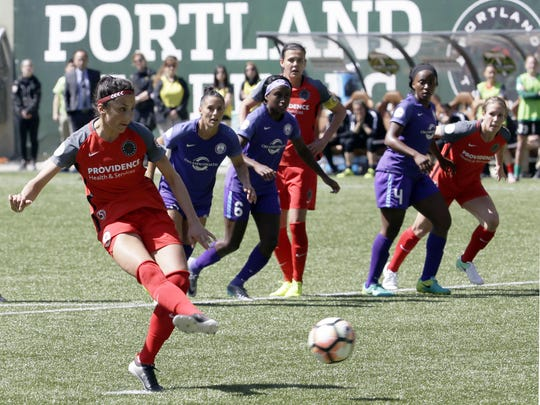 Portland Thorns forward Nadia Nadim, left, takes a penalty shot during the first half of an NWSL soccer match against the Orlando Pride in Portland, Ore., Saturday, April 15, 2017. Nadim scored on this shot. (AP Photo/Don Ryan)