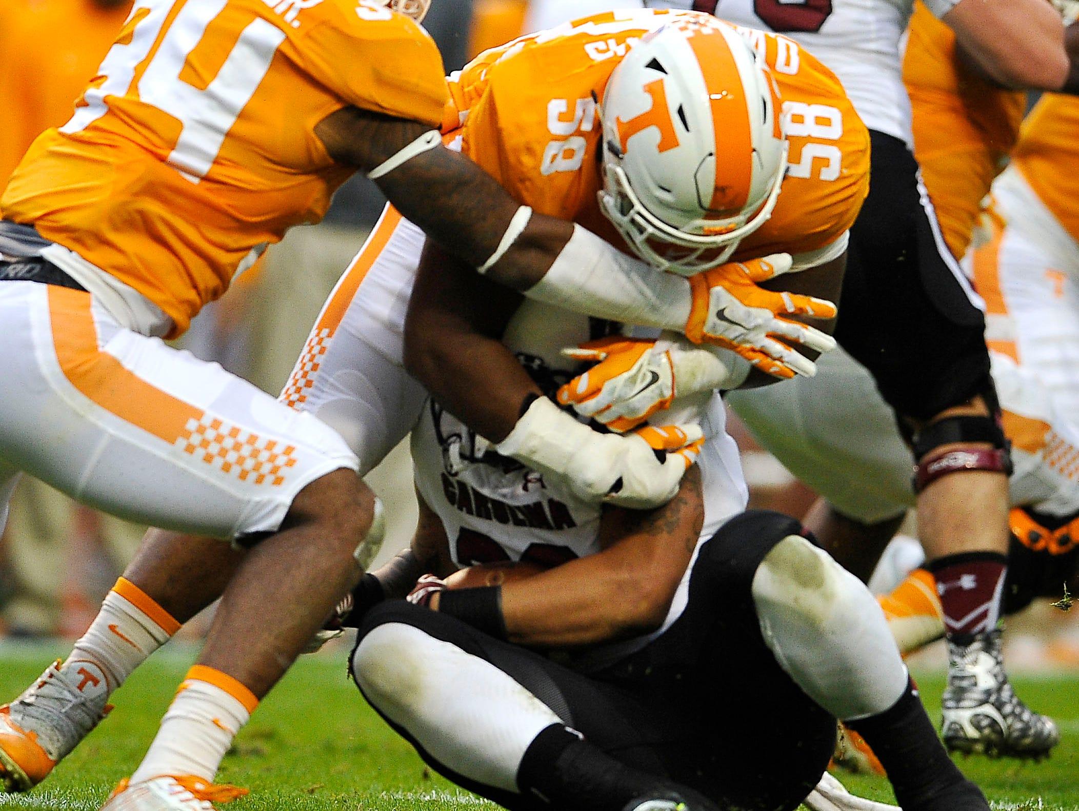 Tennessee defensive lineman Owen Williams (58) and linebacker Darrin Kirkland Jr. (34) cover up South Carolina running back Brandon Wilds (22) on Nov. 7, 2015.