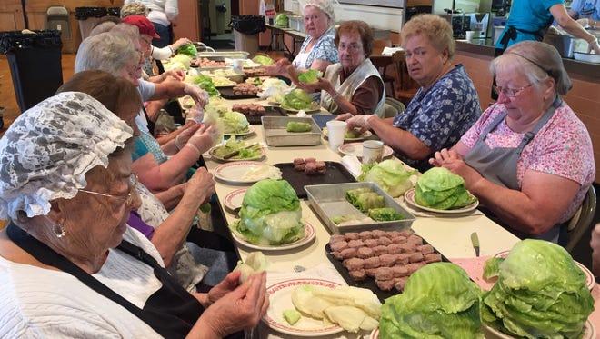 Volunteers with St. Michael's Orthodox Church in Binghamton prepare holupki  in preparation for last year's  Carpathian Festival.