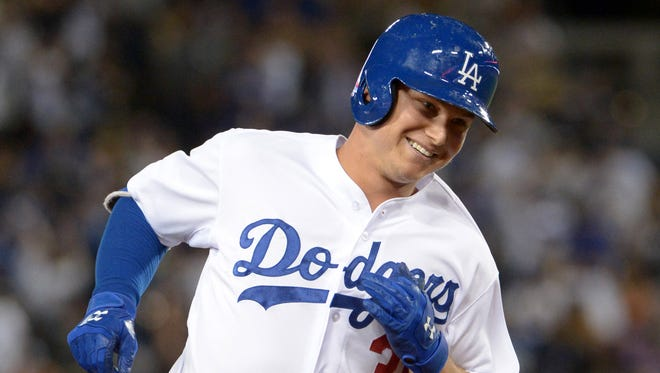 Joc Pederson homered, doubled in a run to lead the Dodgers.