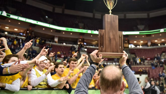 Moeller's Athletic Director, Mike Asbeck, celebrates with the Moeller students Saturday, March 24th at Value City Arena