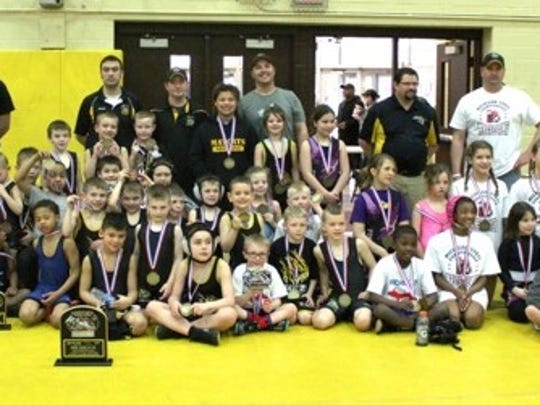 The South Lyon Matcats won the girls eighth- and boys- third-grader and under dual titles.