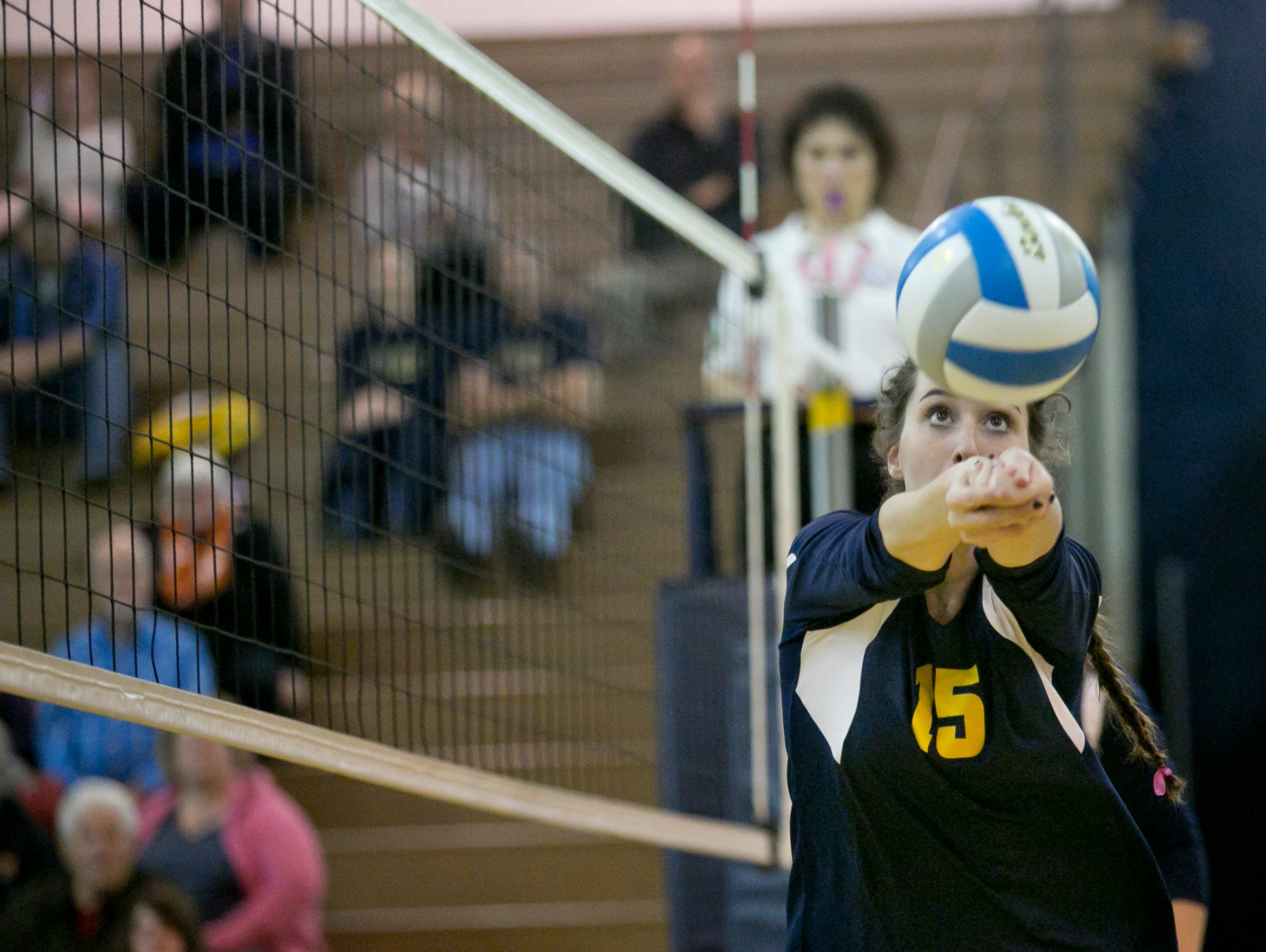 Port Huron Northern senior Carmen Rankin bumps the ball during a volleyball game Tuesday, October 27, 2015 at Port Huron Northern High School.