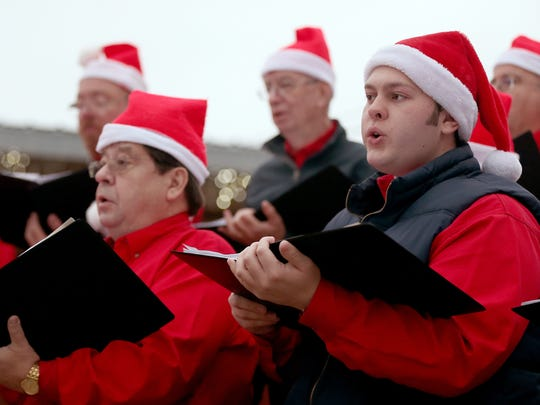 The Twin Mountain Tonesmen sing for community residents during the Christmas tree lighting ceremony on Saturday evening.