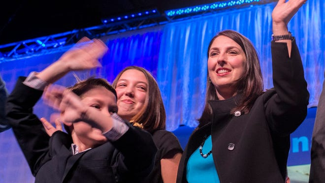 Ronna Romney-McDaniel with her two children Abigail and Nash at the Michigan Republican Party Convention at the Lansing Center on Saturday. Romney-McDaniel was chosen as the state party chair.
