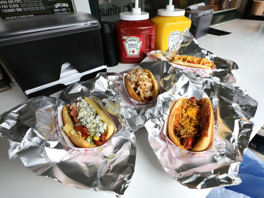 From left: The Bob Ross; The Dog Den; The Sweet Mary and the Bill Murray, rear, at The Dog Den, a new hot dog establishment at 1 Main Street in White Plains, July 6, 2018.