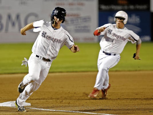 From left, Southern California Renegades' Sheldon Borson and Brady Shockey score runs against D-Bat Elite on Tuesday during Game 16 of the Connie Mack World Series at Ricketts Park in Farmington.