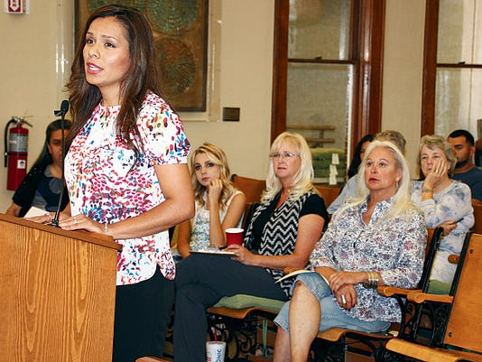 Bill Armendariz - Headlight Photo   CASA Program Director Mayra Solis addressed the Luna County Board of Commissioners during a recent meeting at the Luna County Courthouse. CASA is Court Appointed Special Advocates who are assigned to children who are involved in the court system.