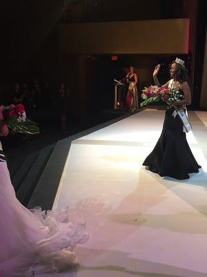 Miss Michigan Teen USA Anane Loveday celebrates Saturday, Sept. 30, 2017, at McMorran Theater in Port Huron.
