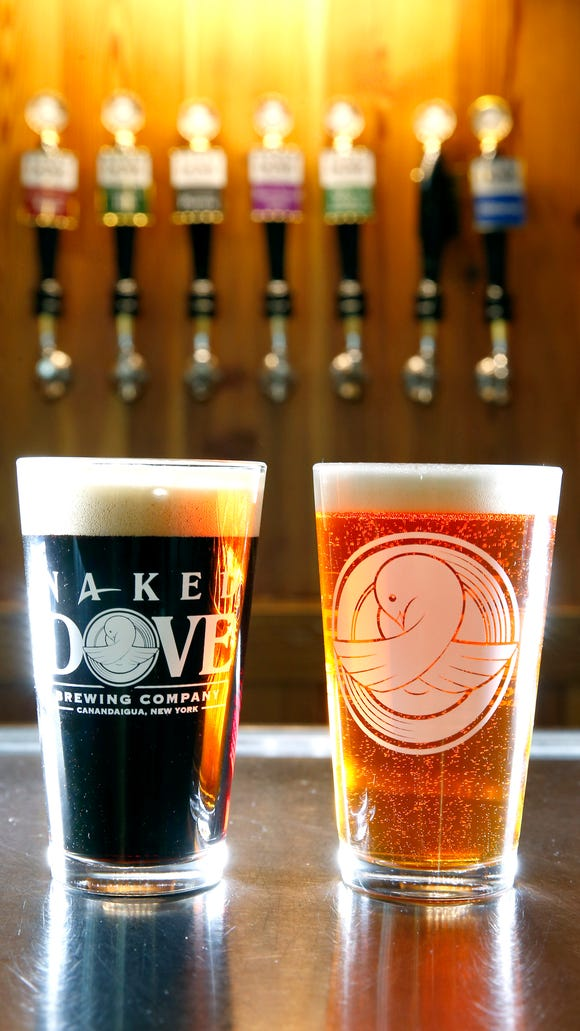 The 45 Fathoms Porter, one of Naked Dove's four core beers, and the Hopulus Localus.
