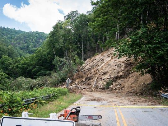 This landslide on N.C. 9 near Bat Cave extends 600 to 800 feet up the slope above the road, the state Department of Transportation says.