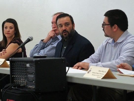 DPS Superintendent Arsenio Romero, center, is flanked by school board members Sophia Cruz, Bayne Anderson, and Matt Robinson.