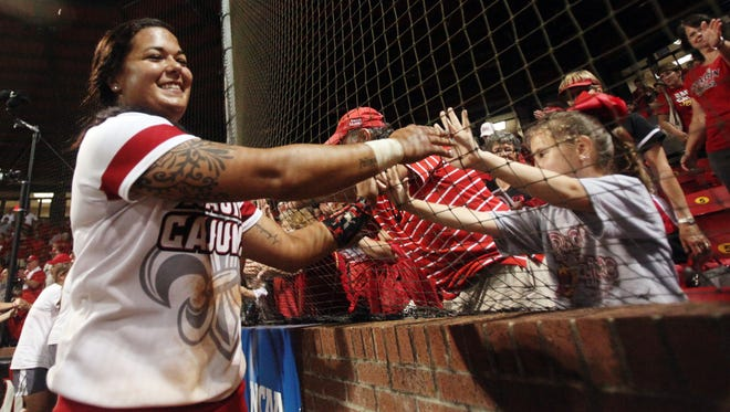 UL Samantha Walsh, who hit the game-ending home run against Baylor, celebrates with fans following the second of two games Sunday, May 17, 2015, during the NCAA Regional Softball Tournament at Lamson Park in Lafayette, La. UL won 9-1.
