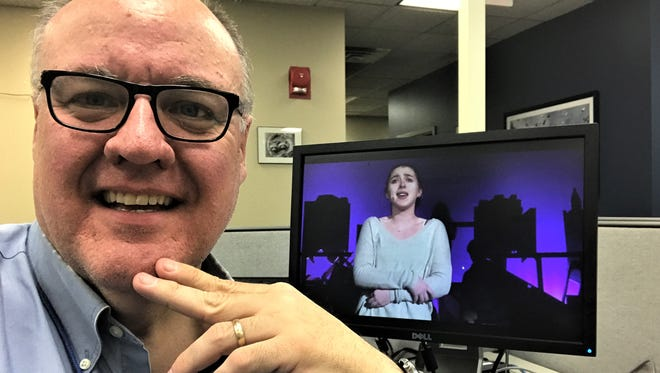 Journal News reporter Peter D. Kramer takes a breather in the office after covering 64 high-school musicals from January through April.
