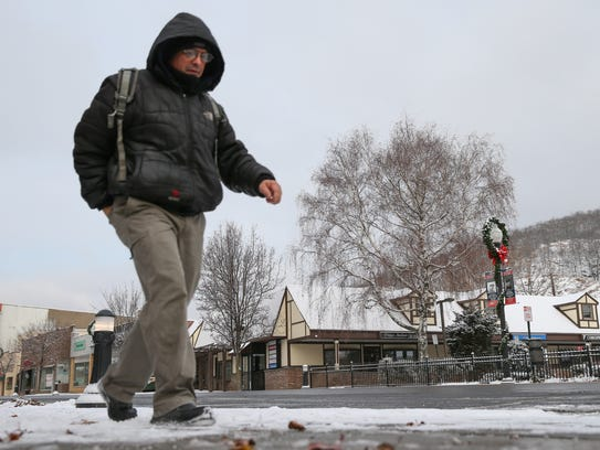 A commuter walks along Lafayette Avenue in Suffern