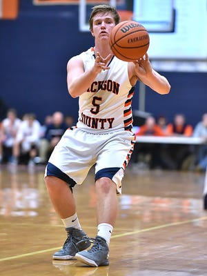 In the boys' game Tuesday, Dickson County's Walker Purvine sunk four 3-pointers for the Cougars.
