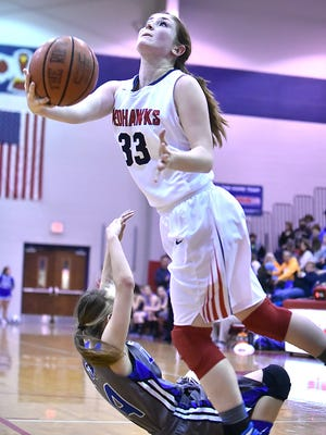 McKenzie Broadway battles her way to the basket at Waverly Thursday and led CW at East Hickman with 17 points Friday.