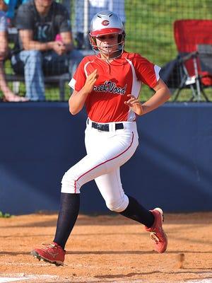 Summer Jackson tags home plate.