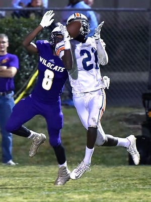 Dickson County defensive back Caleb Rozar breaks up a pass to seal the Cougars win at Clarksville.