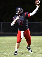 Creek Wood quarterback Devon Higgins finds an open