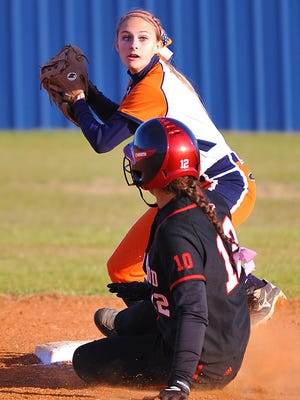 Rachel Rife makes the play at second base for Dickson Co. during the Lady Cougars win over Ravenwood.