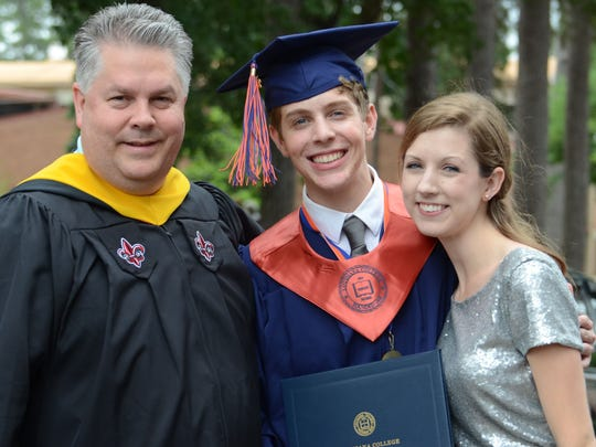 Town Talk reporter Miranda Quartemont (right) poses with her fiancé, Mark Klein, (middle) and father, Al Quartemont, assistant professor of journalism at Louisiana College, after the school's 158th commencement. Klein graduated on Saturday with honors and a degree in Convergence Media.