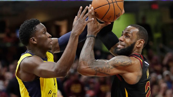 Cleveland Cavaliers' LeBron James, right, drives past Indiana Pacers' Victor Oladipo in the first half of Game 5 of an NBA basketball first-round playoff series, Wednesday, April 25, 2018, in Cleveland. (AP Photo/Tony Dejak)