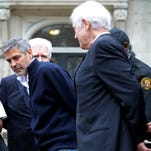 Actor George Clooney and his father, Nick Clooney, right, are arrested during a protest at the Sudanese Embassy in Washington in 2012.