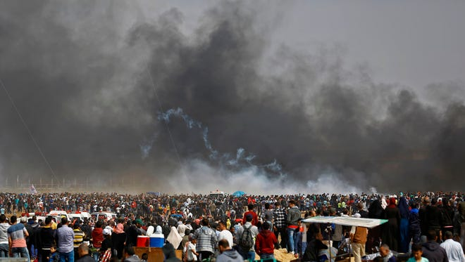 Palestinians demonstrate during clashes with Israeli security forces near the eastern border of the Gaza Strip, east of the northern town of Jabalia, on April 27, 2018, on the fifth straight Friday of mass demonstrations and clashes along the Gaza-Israel border.