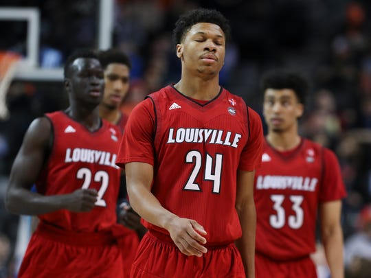 U of L's Dwayne Sutton (24) and his teammates were somber as they walked off the floor during a timeout in the final minutes of their loss to Virginia in the ACC Tournament in Brooklyn, NY.    Mar. 8, 2018
