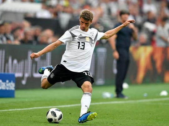Germany's Thomas Muller has scored 10 goals in his first two World Cups and will be looking to help Germany make a rare repeat.