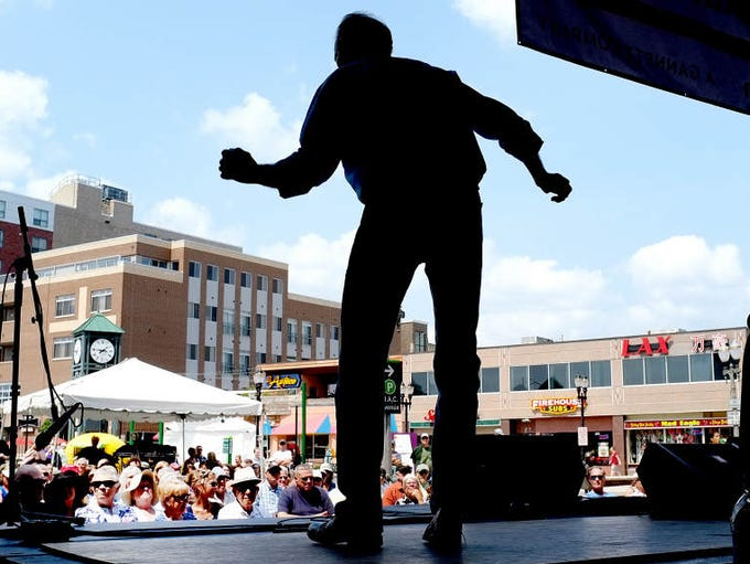 Thomas Maupin performs buck dancing on the final day of the Great Lakes Folk Festival in East Lansing Sunday.