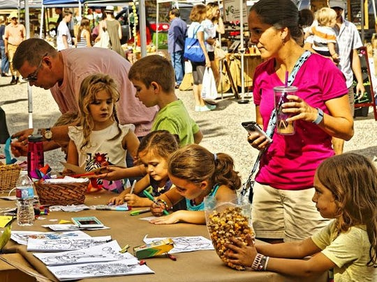 Craft tables for kids are set up throughout the market.